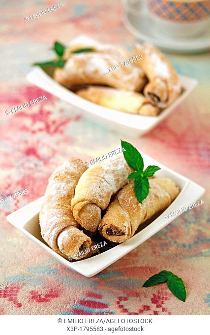 Puff pastry rolls with chocolate and walnuts