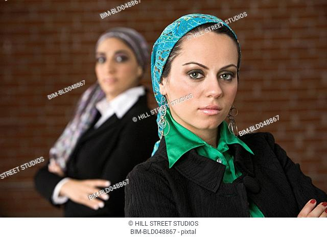 Middle Eastern businesswomen with arms crossed