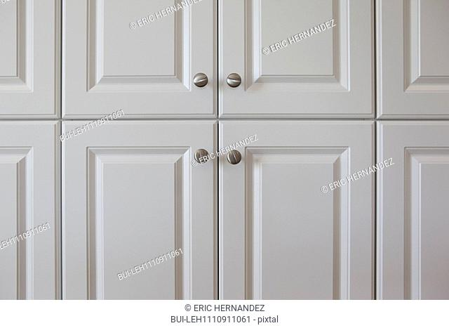 Detail shot of white closed cabinets