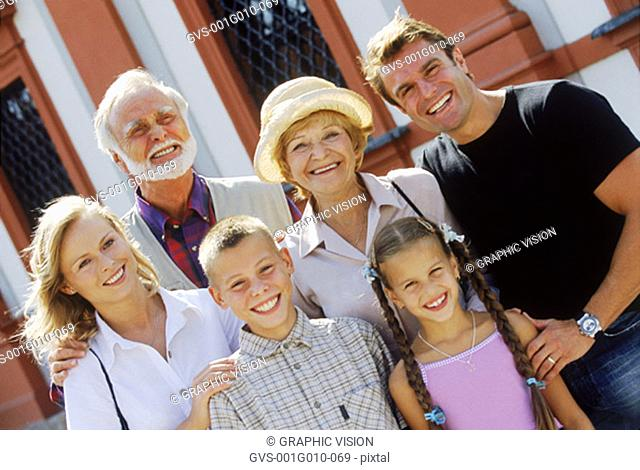 Portrait of a family standing smiling