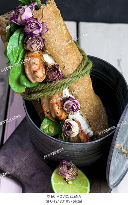 Baguette sandwich with prawns and dried rose buds
