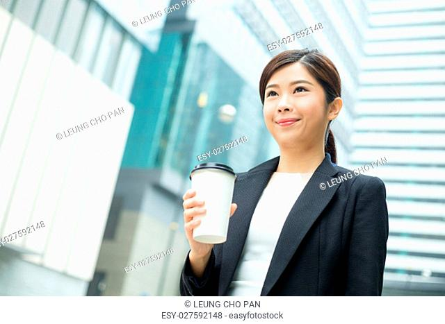 Businesswoman holding a coffee cup