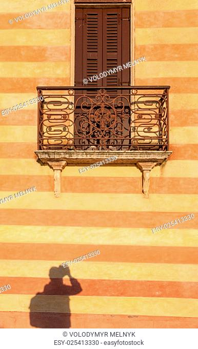 door with balcony in venetian style on Verona street, Italy