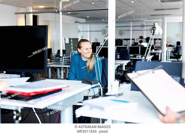 Smiling woman sitting in office