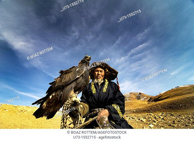 A Kazakh eagle hunter with his Golden eagle in western Mongolia