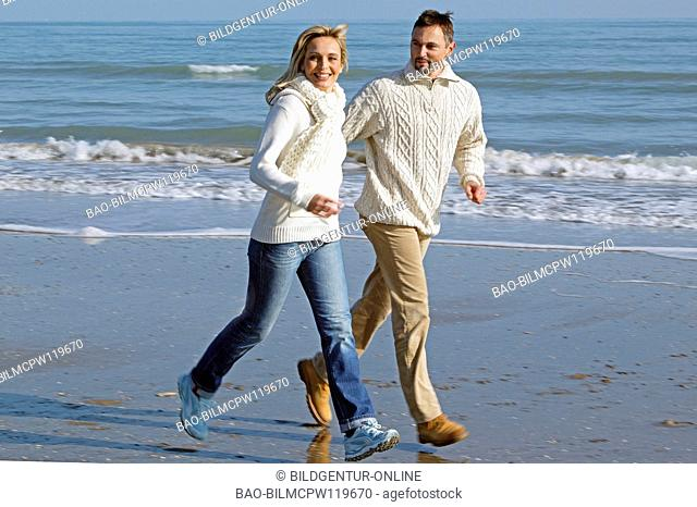couple having fun by the sea