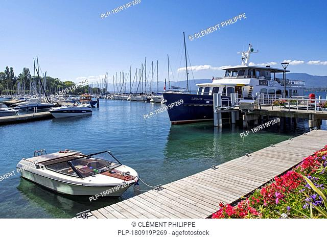CGN passenger ferry boat Lavaux and sailing boats in the marina at Yvoire along Lake Geneva / lac Léman, Haute-Savoie, France