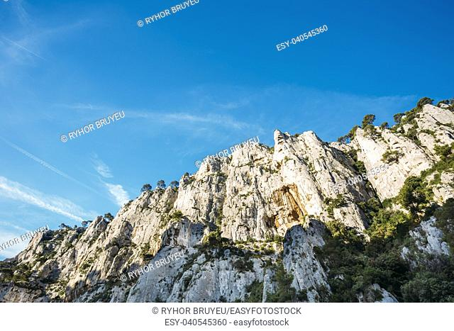 Nature Of Calanques On The Azure Coast Of France. High Cliffs Under Blue Sunny Sky. Copy Space