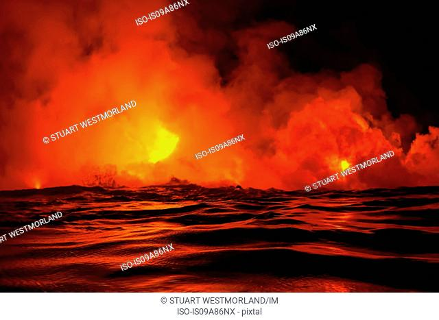 Lava flow into sea at night, Kilauea volcano, Hawaii