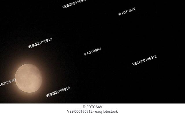 Moon movement in the mist - Night scene time-lapse
