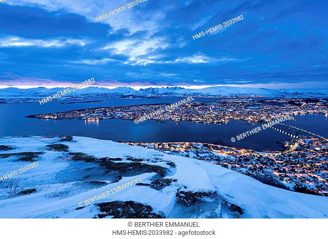 Norway, Lapland, Troms, Tromso, the city at dusk from Mount Storsteinen