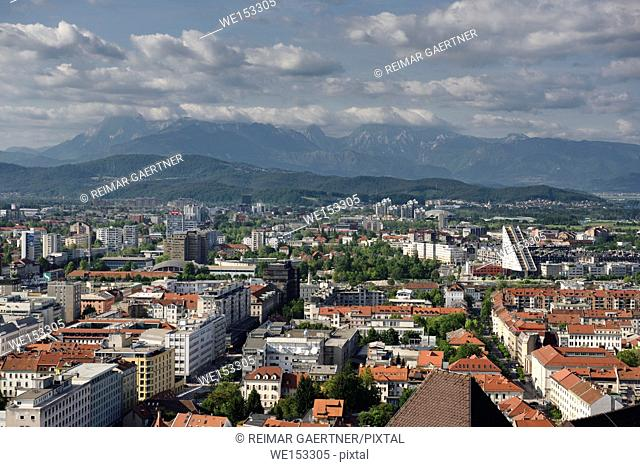 Overview of Ljubljana capital city of Slovenia with Mount Saint Mary and distant Kamnik Savinja Alps mountains from the hilltop Ljubljana Castle