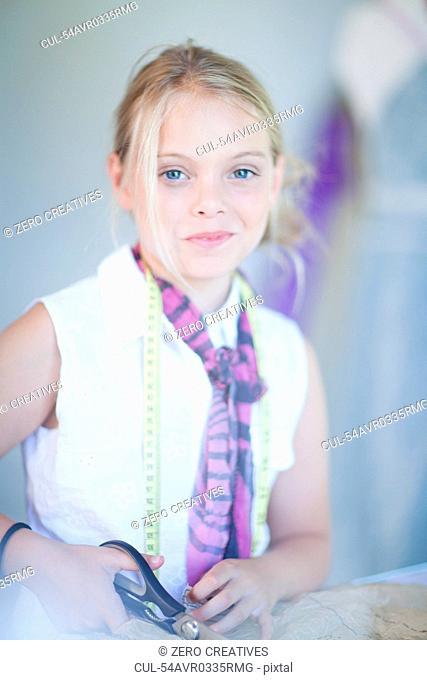 Girl using pair of scissors