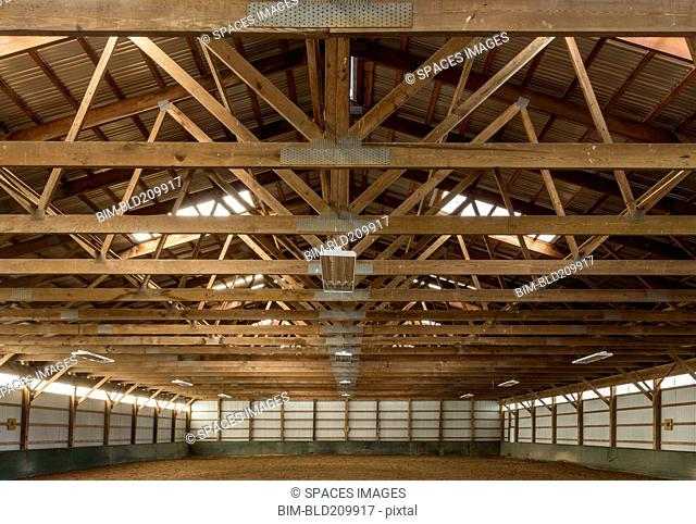 Wooden rafters in indoor horse riding ring
