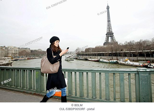 Woman using cell phone on waterfront