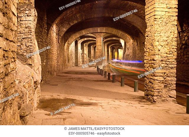 Former silver mines today form a fantastic labyrinth of subterranean traffic tunnels beneath downtown Guanajuato, Mexico as cars pass by in a long exposure...
