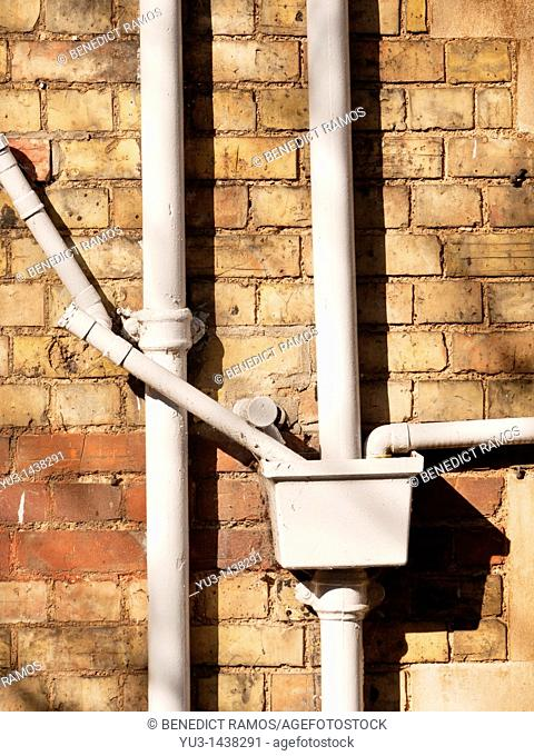 Ironwork drainage pipes on Victorian building, Oxford, UK