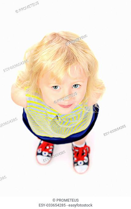 Angelic little girl with beautiful blonde hair. Happy childhood. Kid's beauty, fashion. Isolated over white