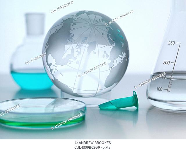 Globe with laboratory flasks and petri dish