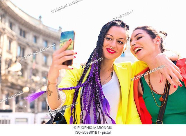 Women taking selfie, Milan, Italy