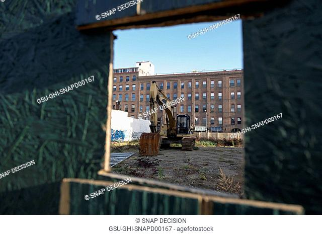 View Through Fence at Construction Site Rubble