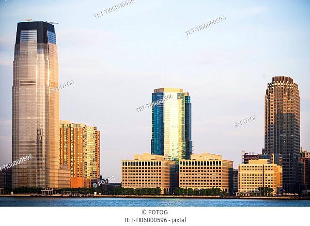 USA, New Jersey, Jersey City, City skyline seen across Hudson River