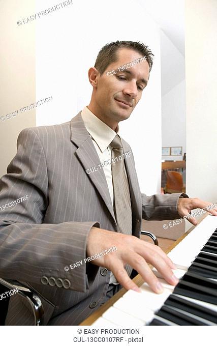 businessman playing piano