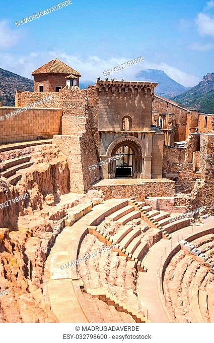 Roman theatre in Cartagena, Spain with mountains at the background. It has a museum and is open for tourists