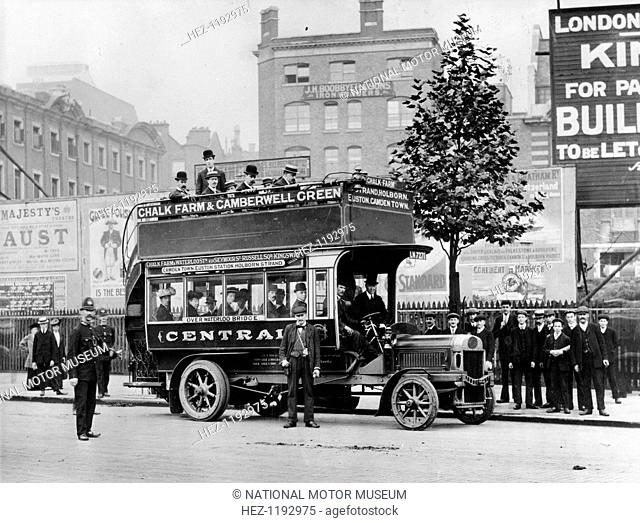1908 Leyland bus, (c1908?). A bus conductor and a policeman standing in front of a double-decker bus on a London street