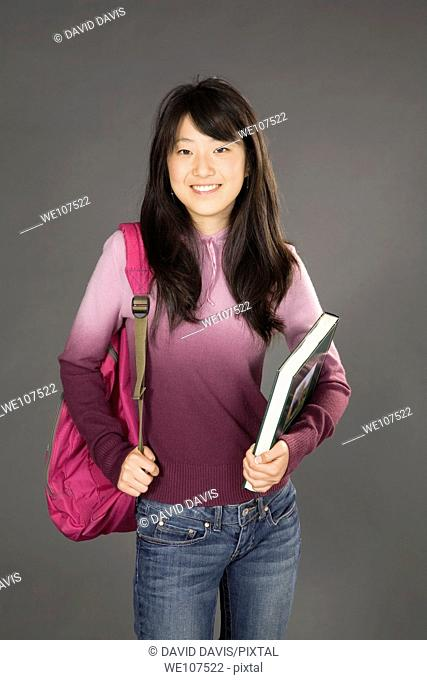 Portrait of Asian teenager getting ready to go to school