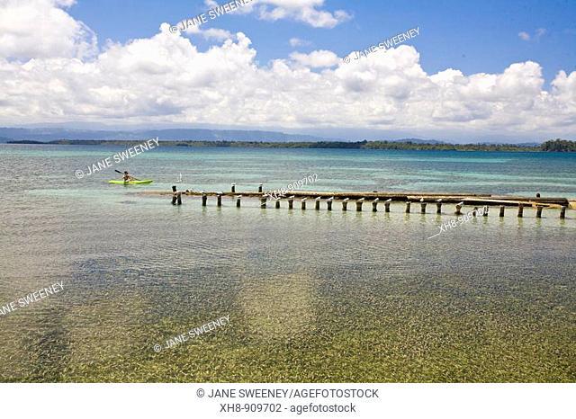 Tourist in sea kayak, Boca del Drago beach, Colon Island, Bocas del Toro Province, Panama