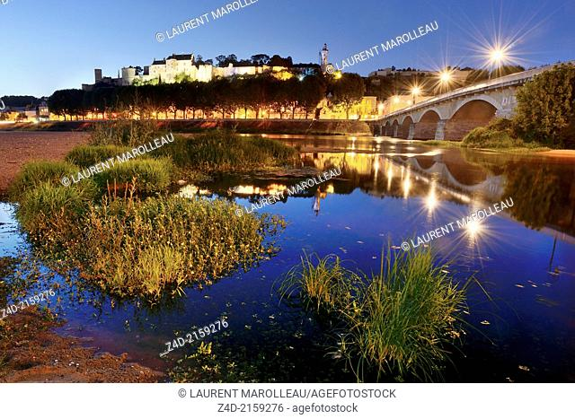 Twilight night exposure on Chinon Fortress and Vienne River. The Royal Fortress of Chinon is situated in the Centre Val de Loire region, overlooking the town