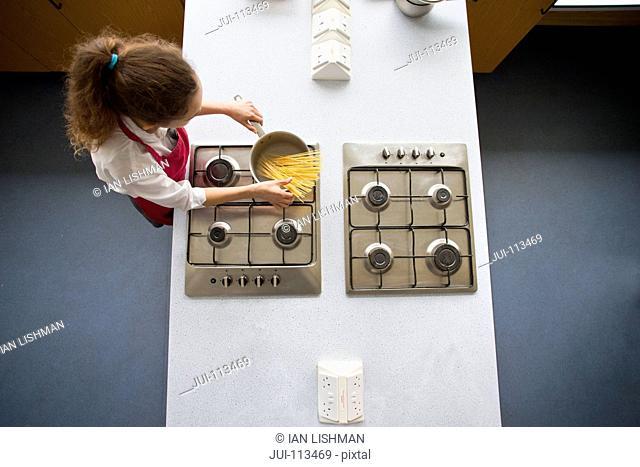 High school student cooking pasta in home economics class