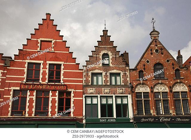 Colorful facades of the traditional buildings on the Market Square, Bruges, West Flanders, Belgium, Europe