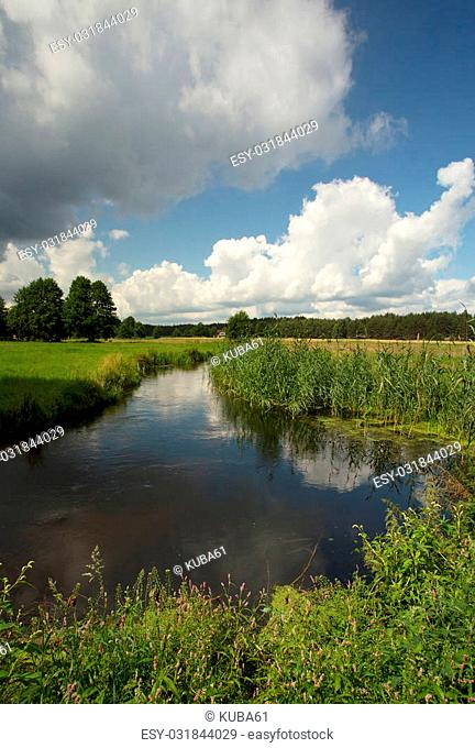 Poland , Bory tucholskie National park in summer.Beautiful and wild river Brda flows among fields, meadows and surrounding forest.Vertical view