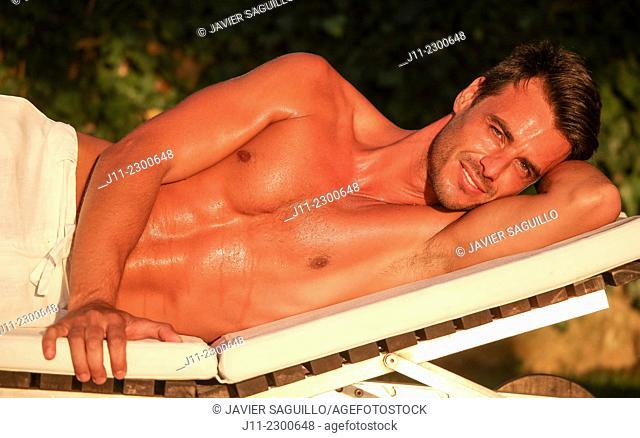 Man lying down on sunlounger