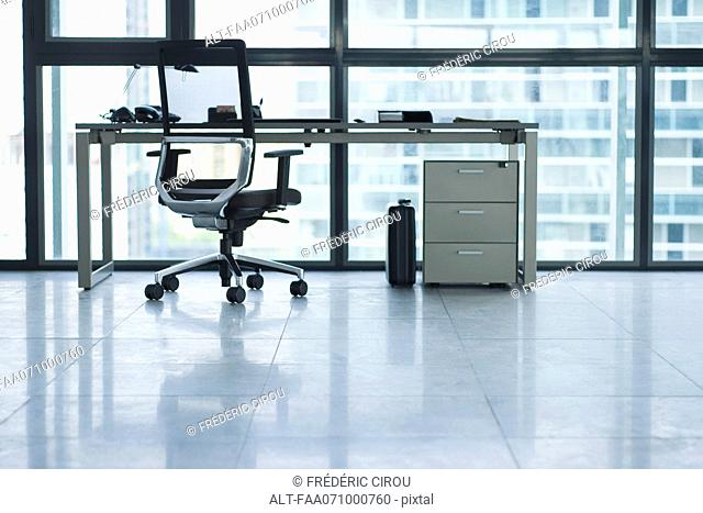 Desk and office chair in empty office