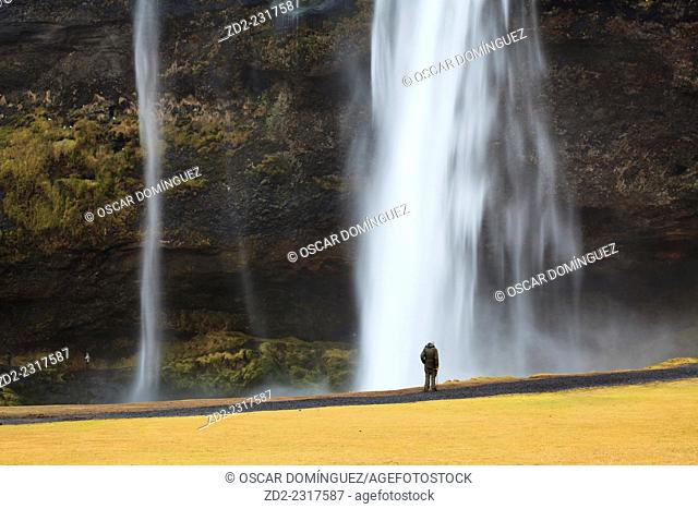 Tourists at Skogafoss Waterfall. Iceland