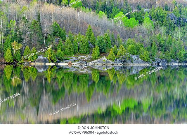 Spring reflections in Simon Lake, Greater Sudbury, Ontario, Canada
