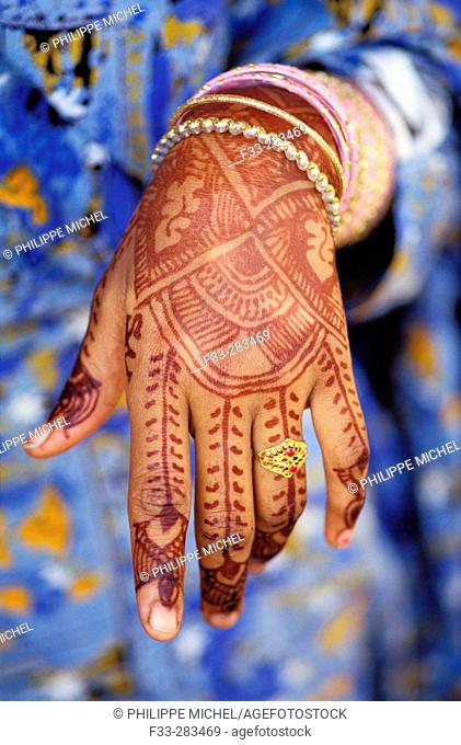 Young Shiddi woman's henna tattooed hand. Pakistan