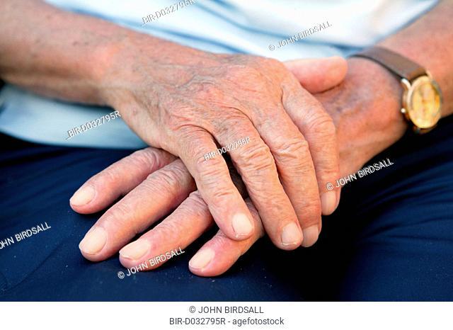 Elderly mans hands on lap