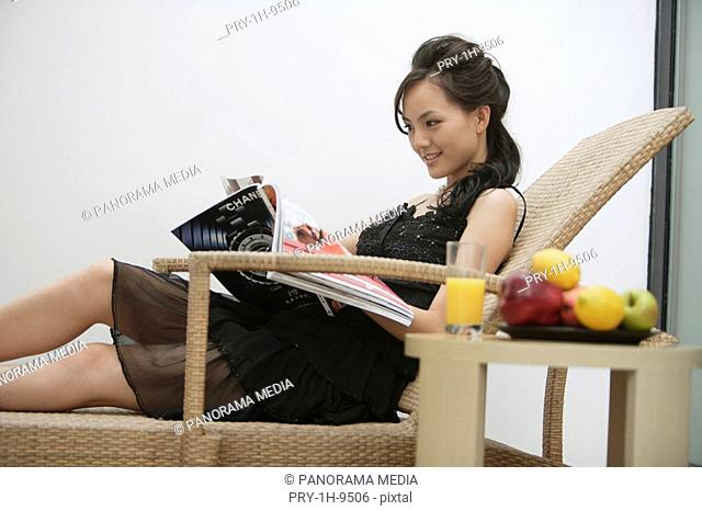 Young woman relaxing in reclining chair