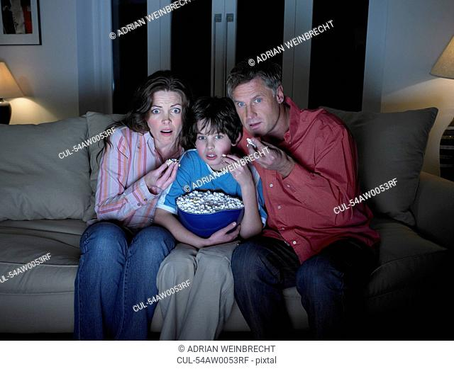 Family watching movie together