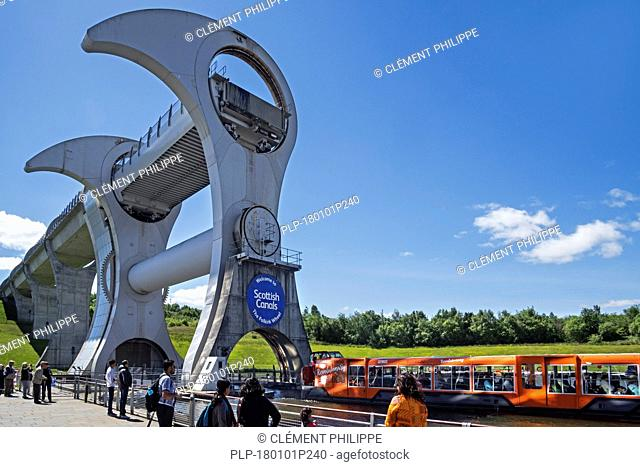 Tourists visiting Falkirk Wheel, rotating boat lift connecting the Forth and Clyde Canal with the Union Canal, Stirlingshire, Scotland, UK