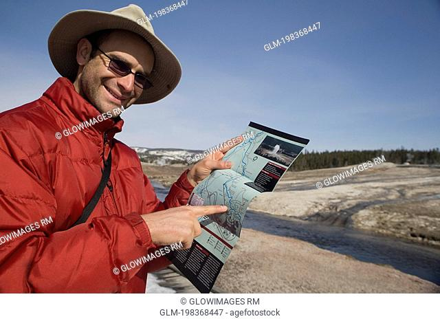 Tourist pointing at a map, Yellowstone National Park, USA
