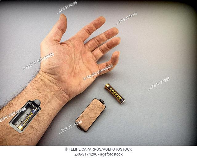 Hand of man with slot for charging batteries, energy concept