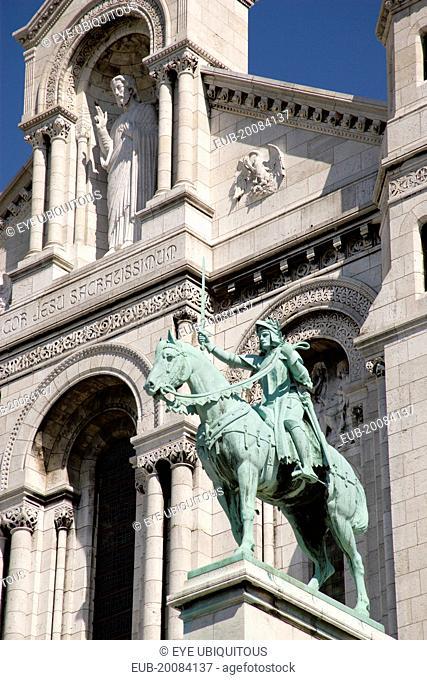 Montmartre The facade of the church of Sacre Couer with the bronze equestrian statue of Joan of Arc by H Levebure