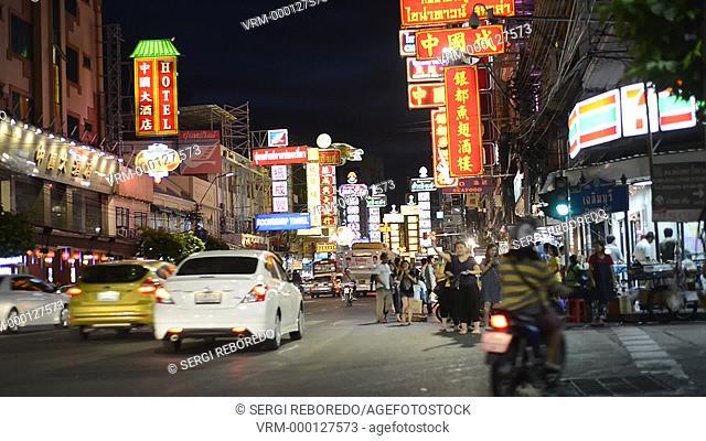 View down Thanon Yaowarat road at night in central Chinatown district of Bangkok Thailand. Yaowarat and Phahurat is Bangkok's multicultural district