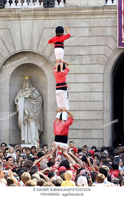 'Castellers' building human towers, a Catalan tradition. Mercè festivals. Plaça de Sant Jaume. Barcelona, Spain
