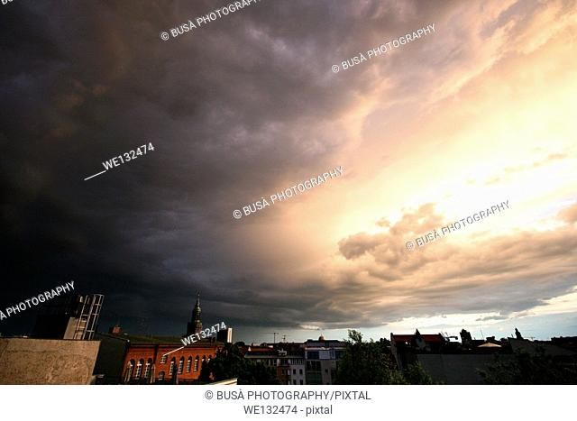Summerstorm in the rooftops of Berlin at dusk